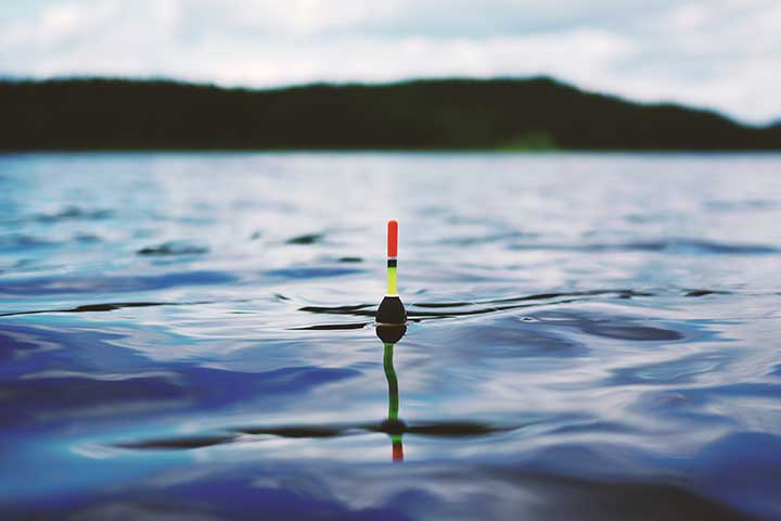 Image of a fishing small fishing buoy on a line